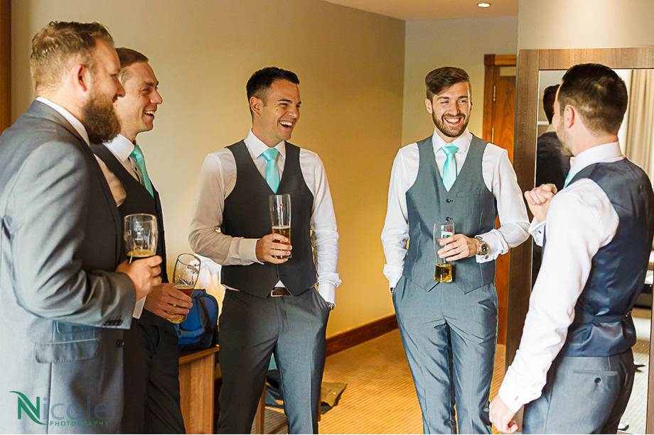 groom and men laughing