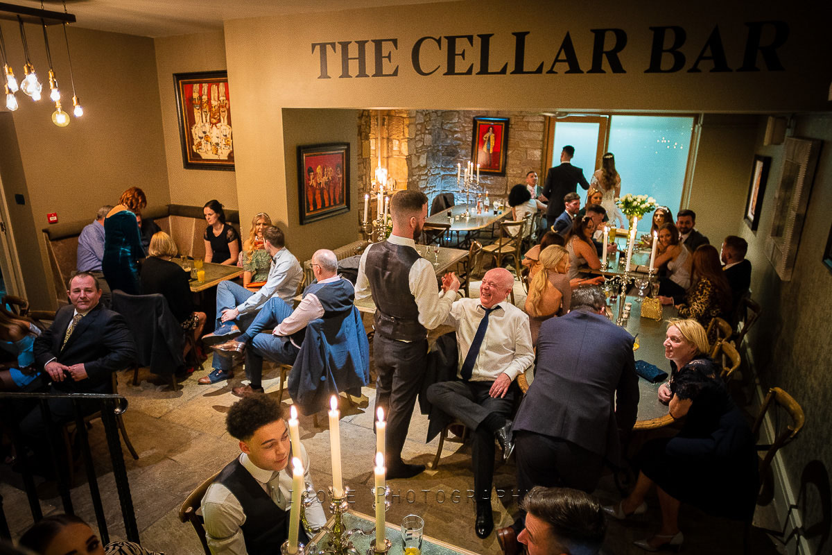 wedding guests in the cellar bar